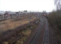 The disused sidings of Smithy Lye are to the left of the City Union <br> line in this view east from Shields Road on 5 February.� The Glasgow and Paisley line is at their other side.� The overhead wire beneath the <br> camera serves the line connecting the CU and the G&P, and the points are currently set for it.<br><br>[David Panton&nbsp;05/02/2011]