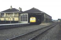 View east at Malton in 1974 with a DMU at the platform. The overall roof was in poor condition and was later demolished, with a replacement canopy coming from Whitby [see image 19600].<br><br>[Ian Dinmore&nbsp;//1974]