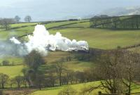 After a break at Buxton, Black 5 no 44871 and Jubilee no 5690 <br> <I>Leander</I> are seen with the return leg of the <I>Buxton Spa Express</I> on 26 February heading east near the 2 mile 182 yard Cowburn Tunnel. The tour had followed a stone train down from Great Rocks Junction and as a result was over 30 minutes late getting away from Chinley East Junction.<br> <br><br>[John McIntyre&nbsp;26/02/2011]