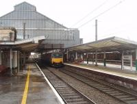 Preston's impressive trainshed, or at least the western half of it, as seen from the north end of Platform 3. 150146 has just arrived in Platform 2 on the hourly Blackpool North to Liverpool Lime Street service. <br><br>[Mark Bartlett&nbsp;26/01/2011]