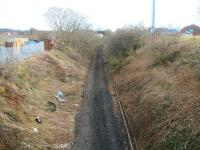 Scene on the Edinburgh, Loanhead and Roslin route approximately 2 miles south west of Millerhill Yard on 2 March 2011. The trackbed here is now clear with recently lifted rails lying alongside. Behind the camera two teams are currently engaged in the recovery of concrete sleepers. View is east from a farm overbridge looking towards the site of  the former Gilmerton station. [See image 36048]<br><br>[John Furnevel&nbsp;02/03/2011]