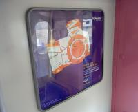 This is a ScotRail poster for Advance tickets, but at first glance I <br> took it to be an encouragement to photograph railways.� I think we can all agree that is a pretty worthless pastime.� The pink colour of the divider shows that it was photographed on one of the five Class 322s which will return south later in 2011, the date depending on the Class 380 rollout.<br><br>[David Panton&nbsp;25/02/2011]
