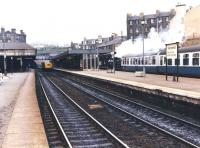 NB 0-6-0 no 673 <I>Maude</I> passing through Haymarket on 4 May 1980 with an SRPS special [see image 32976]. Approaching in the opposite direction along platform 2 is a class 40 running light engine having just left Haymarket Tunnel, presumably on its way to Haymarket MPD. <br><br>[Jim Peebles&nbsp;04/05/1980]
