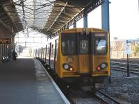 Merseyrail EMU 507010 stands at Platform 7b of Chester Station on 2 March awaiting its 15.46 departure time to return to Liverpool Central via Hooton.<br><br>[David Pesterfield 02/03/2011]