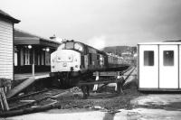 Having recently arrived with a train from Inverness, no 37415 stands at the platform at Kyle of Lochalsh under ever darkening skies on an August afternoon in 1987.<br> <br><br>[John McIntyre&nbsp;/08/1987]