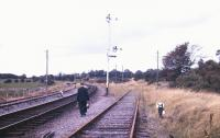 The lamp man cometh... railwayman carrying lamps for signals at Claremorris, County Mayo, in 1988.<br><br>[Ian Dinmore&nbsp;//1988]