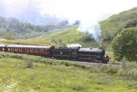 62005 starts the climb west from Glenfinnan station with <I>The Jacobite</I> on 26th June 2010. <br><br>[Colin Miller&nbsp;26/06/2010]