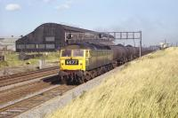 Brush Type 4 D1795 has just passed� Bowesfield signal box, standing at the eastern apex of the triangle of lines to the west of Tees Yard and south of Stockton. The train is a Teesport to Jarrow block oil working, photographed in October 1970. <br> <br><br>[Bill Jamieson&nbsp;02/10/1970]