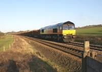 Colas Rail Class 66 no 66843 heads west passed Gregson Lane towards the WCML with the daily Carlisle to Chirk log train on 1 March 2011.<br> <br><br>[John McIntyre&nbsp;01/03/2011]