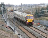The 10.39 from Helensburgh Central meets the 11.21 from Edinburgh Waverley just to the east of Caldercruix station on 7 March 2011.<br><br>[John Furnevel&nbsp;07/03/2011]