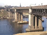 The King Edward Bridge as seen in mid-afternoon from the�south bank of the Tyne at the very end of September 1970. (The picture was taken as a record of the bridge rather than as a photograph of the�train of vans, which is headed by class 37 no 6874.)<br><br>[Bill Jamieson&nbsp;30/09/1970]