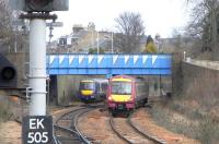 170s off the north end of Kirkcaldy station, one in the siding and the other on the Up line, on Sunday 6 March.� The siding is not normally used on a Sunday as there are no terminating trains, but a special timetable was in place for engineering work diversions.� Note the painting of Bennochy Road overbridge.� There was a fad in the 1980s for painting such bridges with geometric shapes.� To today's eyes it has the effect of drawing attention to something humdrum without making it attractive.� How tastes change.<br><br>[David Panton&nbsp;06/03/2011]