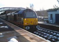 EWS 67005 hauling the Rail-Blue Charters <I>'Winter Highlander'</I> from Darlington to Inverness, photographed at Carrbridge station on 11 March 2011<br><br>[Gus Carnegie 11/03/2011]