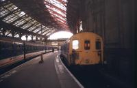 Looking back along the platform towards the buffer stops and concourse at Brighton in November 1991 as 4-CIG and 2-HAP units await their departure times under the the station's overall roof.<br><br>[Ian Dinmore&nbsp;/11/1991]