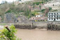 View across the Avon on 11 March, a short distance south of the former Hotsprings railway terminus, showing abandoned landing stages and the lower entrance to the Clifton Rocks Railway, built into the face of the Avon Gorge [see image 17977]. The former funicular railway, closed in 1934, is currently the subject of  considerable preservation activity. <br><br>[Peter Todd&nbsp;11/03/2011]