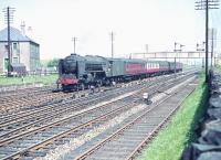 View east from alongside Saughton Junction in June 1958 as A2 Pacific no 60509 <I>Waverley</I> approaches with a motley collection of coaching stock heading for the Forth Bridge.<br><br>[A Snapper (Courtesy Bruce McCartney)&nbsp;23/06/1958]