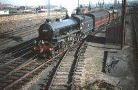 B1 no 61343 brings coaching stock destined for Waverley out of Craigentinny carriage sidings on 30 September 1959. Seen in the background, just above the B1's tender, is the tunnel inspection train [see image 27043].<br><br>[A Snapper (Courtesy Bruce McCartney)&nbsp;30/09/1959]