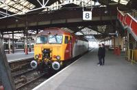 Having dragged a Pendolino set off the North Wales line into <br> Platform 11 at Crewe with a London bound service, 57304 <I>Gordon Tracy</I> now stands in the Platform 8 bay on 12 March, where it is being admired by two young enthusiasts.<br> <br><br>[John McIntyre&nbsp;12/03/2011]