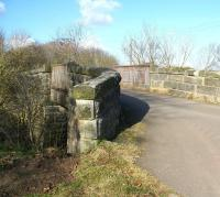 The slightly mis-shapen 137 year old road bridge still spanning the trackbed just north of the site of Roslin station on 28 February 2011. [See image 37223] <br><br>[John Furnevel&nbsp;28/02/2011]
