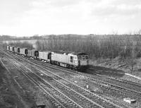33102 passing Fairwood Junction, Westbury, in February 1990 with a stone train from the Somerset quarries. The train is heading into the Westbury marshalling yards. <br><br>[Peter Todd&nbsp;21/02/1990]