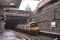 320313 emerges from below the M8 at Charing Cross on 15 March with an eastbound service.� The dome of the Mitchell Library dominates the skyline.<br><br>[Bill Roberton&nbsp;15/03/2011]