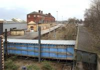This is the part of Crewe station that most passengers don't normally see. These former through tracks and platforms located on the west side of the station are now truncated, with a covered scaffolding walkway crossing the formation. Photographed on 12 March 2011.<br><br>[John McIntyre&nbsp;12/03/2011]