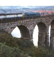 Class 46 no 139 leaves Berwick on 12 September 1970 and runs onto the Royal Border Bridge with train 1E03, the 08.08 Edinburgh - Newcastle�semi-fast, conveying mail, parcels and passengers.� Besides calling at Drem and Dunbar this train also stopped at the Northumberland stations (excepting Pegswood) between Berwick and Morpeth, from where it had a fast run into Newcastle.<br> <br><br>[Bill Jamieson&nbsp;12/09/1970]