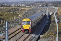 334 015 leaves Caldercruix with an eastbound service on 16 March 2011.<br> <br><br>[Bill Roberton&nbsp;16/03/2011]