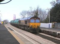 66 003 brings an aviation fuel train off the Forth Bridge and through Dalmeny station on 16 March 2011 before taking the Winchburgh line.<br><br>[David Panton&nbsp;16/03/2011]