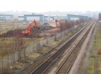 After several false starts work is finally underway on the new Buckshaw Parkway station on the former Royal Ordnance Factory site between Euxton Junction and Chorley, seen here on 16 March 2011. In addition to the industrial units there are now over 1800 houses off to the left with more being built. To the right is part of Runshaw College. Further info about the station and village itself is available on the web. [See image 20909]<br><br>[John McIntyre&nbsp;16/03/2011]