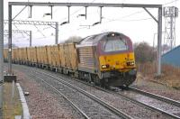 67004 leans into the curve approaching Prestonpans on 17 March with the 6B45 Powderhall - Oxwellmains <I>Binliner</I> refuse containers.<br><br>[Bill Roberton&nbsp;17/03/2011]