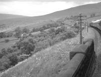 Northbound over Dent Head Viaduct on 9 July 1961. The train is the  R.C.T.S. (West Riding Branch) 'Borders Rail Tour' behind 46247 <I>City of Liverpool</I>. The special will soon pass Dent Head signal box, which is partially obscured by the nearest telegraph pole.<br><br>[K A Gray&nbsp;09/07/1961]