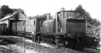 Ex LB&SCR D1 0-4-2T <I>James Fryar</I> and the post war CMHW passenger stock standing outside the shed in the yard at Whittingham Hospital, prior to working a service to Grimsargh. The shed is still used as a NHS workshop [See image 33027]. The former No. 2357 was purchased from the Southern Railway in 1947 for �750 and it was older than the hospital line. It was the last survivor of its class but when the boiler expired in 1955 it was laid aside and sadly scrapped when the line closed. <br><br>[David Hindle Collection&nbsp;//]