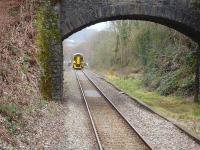 A 158 on a Maesteg to Cheltenham service approaches Sarn, where it will form the 10.32 departure. The unit is passing a lower quadrant home signal protecting the junctions at Tondu.<br><br>[David Pesterfield&nbsp;10/03/2011]
