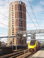 This imposing tower block overlooks the west end of Leeds station. Presumably resident enthusiasts opt for flats on this side of the building. Cross Country Voyager 220026 runs in from the south.  <br><br>[Mark Bartlett&nbsp;19/03/2011]