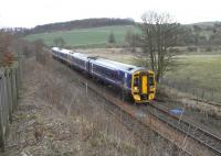 A 4-car 158 set approaches Markinch with an Inverness to Edinburgh <br> service on 19 March.� The rear of the train is passing the crossover <br> once used for reversing by the hourly terminating service from <br> Edinburgh.� It doesn't see much use since the service pattern changed and Markinch lost its terminating trains, though there are more through services.� Note the HST car stop sign way off the end of the platform.� Markinch has had an HST service (by Virgin) though three other Fife stations with the 'stranded H' never have.<br> <br><br>[David Panton&nbsp;19/03/2011]
