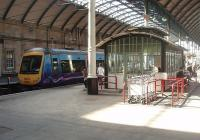 Hull Paragon station is impressive from any angle and contains lots of interesting features, not least this waiting room on one of the platforms. A Trans Pennine Clas 170 is waiting alongside for its next duty. <br><br>[Mark Bartlett&nbsp;19/03/2011]