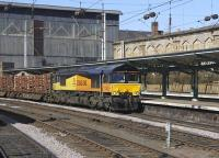 Colas Rail 66843 runs through Carlisle with the 6J37 Kingmoor - Chirk timber train on 19 March 2011.<br><br>[Bill Roberton&nbsp;19/03/2011]
