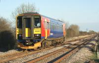 Having left Sleaford eastbound on 18 March, East Midlands railcar 153357 has turned south-east at Sleaford South Junction a few hundred yards behind the photographer and is now heading for Spalding and Peterborough. This is contrary to the destination panel display which is showing <I>Lincoln Central</I>, the starting point of the service.<br> <br><br>[John McIntyre&nbsp;18/03/2011]