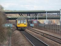 With the M1 Tinsley viaduct in the background 142087, heading for Swinton, races a Sheffield Supertram away from Meadowhall. The tram will swing right before the bridge to return to the city centre while the Pacer is bound for Doncaster and Scunthorpe.<br><br>[Mark Bartlett&nbsp;19/03/2011]