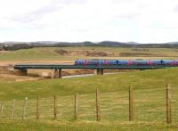 The 10.00 Manchester Airport - Edinburgh Waverley TransPennine DMU crosses Float Viaduct over the River Clyde on 21 March on the south eastern approach to Carstairs.<br><br>[John Furnevel&nbsp;21/03/2011]