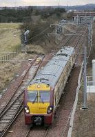 <I>White Elephant East Junction....?</I>  334 002 passes the eastern connection to the cancelled STVA car terminal on 26 March with the 17.01 from Bathgate to Edinburgh Waverley. [See image 18357]<br><br>[Bill Roberton&nbsp;26/03/2011]