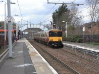 318 262 calls at Blantyre on 26 March with a service for Larkhall.  <br> Uniquely for the SPT network the station building retains its <br> Strathclyde Red branding, the image before last.<br> <br><br>[David Panton&nbsp;26/03/2011]