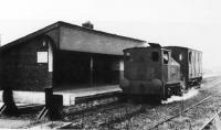 Shortly before final closure in 1957, Sentinel locomotive <I>Gradwell</I> stands at Grimsargh (CMHW) station with a single converted LNWR brakevan. Previously three of these vehicles had been required for the passenger services but one was sufficient towards the end. The Whittingham Hospital line was believed to be the only railway in the country where a Sentinel geared locomotive was regularly used to haul passenger services. <br><br>[David Hindle Collection&nbsp;//1957]