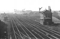 View west at Saughton Junction, seen  through a telephoto lens, late one afternoon in March 1972. The location was still a junction at that time and the signal box still operational, although the former carriage sidings beyond the box had gone and little remained of the old goods yard off to the left. As for Saughton station, opened in 1842 (as Corstorphine) and closed in 1921, nothing remains (other than the bricked-up entrance on Saughton Road). [See image 25903].<br> <br><br>[Bill Jamieson&nbsp;/03/1972]