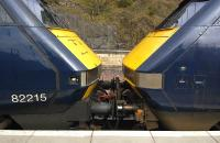 <I>'We have to stop meeting like this...' </I> East Coast DVT 82215 and power car 91108 face up at Waverley with an empty stock working to London on 29 March.  The DVT was defective, hence the 91 leading 'blunt end' first.<br> <br><br>[Bill Roberton&nbsp;29/03/2011]