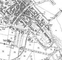 An extract from the 1899 map of Campbeltown showing the original terminus of the light railway, prior to the introduction of passenger services. At this time coal from the collieries between here and Machrihanish was probably the sole traffic. Later the railway was extended onto the quayside via reclaimed land on the foreshore. [See image 33469]<br><br>[Mark Bartlett&nbsp;//1899]