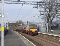 320 320 runs into Easterhouse station with an Airdrie service on 26 March 2011.<br><br>[David Panton&nbsp;26/03/2011]