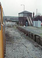 Daisyfield box, level crossing and former Blackburn-bound platform (now removed) seen from a 47456 hauled train diverted from the WCML due to engineering works and heading north for Hellifield. Taken on the 25th of March, 1989.<br><br>[Ewan Crawford&nbsp;25/03/1989]