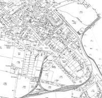An extract from the 1921 map of Campbeltown showing the light railway now extended from the 1899 route [See image 33448] through a cutting and onto the town's quayside over reclaimed land. A triangular junction has also been created near the railway depot. By this time the passenger service had been operating for around fifteen years but within ten years from this date would cease following which the railway was dismantled. <br><br>[Mark Bartlett&nbsp;../../1921]